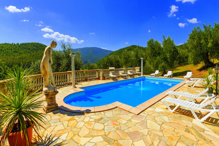 Pool set within Tuscan countryside
